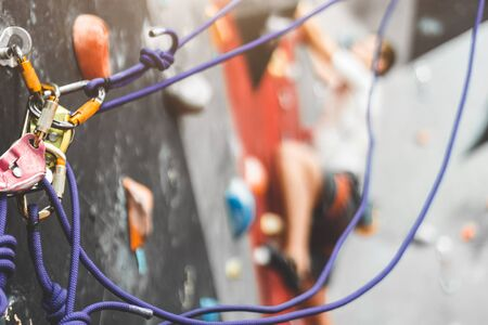 Close-up detail of rock climber wearing safety harness and climbing equipment outdoor. climbing carabiner insurance