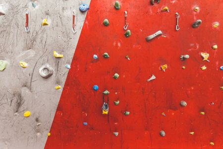 steep rock, climbing on artificial wall indoors. Extreme sports and bouldering concept 스톡 콘텐츠 - 129376640