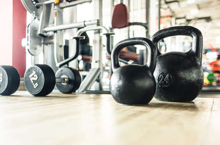 Kettlebells in the interior of the gym without people. 写真素材