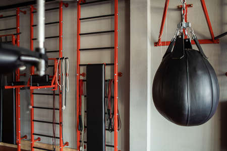 Punching bag interior gym without people.Close-up