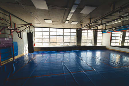 The interior of the gym and a place for group classes. Silhouette photo in front of the window
