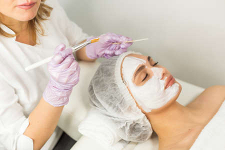 Facial skin care and protection. A young woman at a beauticians appointment
