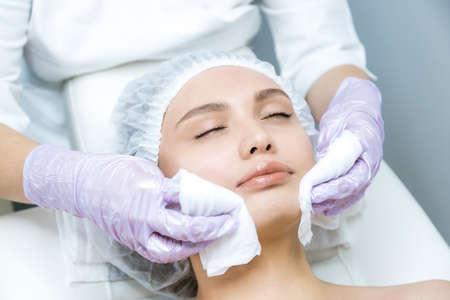 Woman doing rejuvenation procedure, Non-surgical face lifting. lifting ultrasonic. Facelift Фото со стока