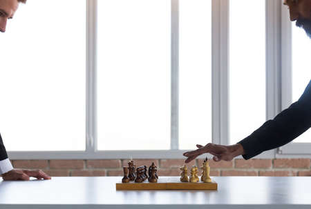 two male businessmen, rivals are playing chess. Strategy and rivalry. Фото со стока
