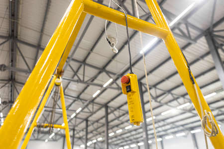 Close up red button. Swivel electric crane hook for overhead crane in the workshop or factory
