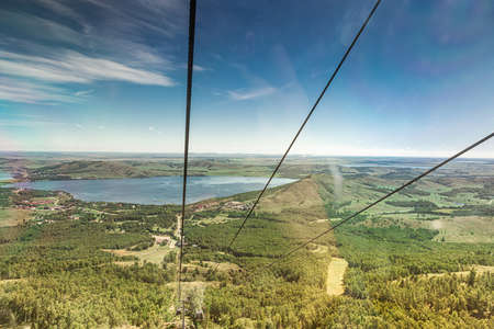 View from the cabin of the cable car on Lake Bannoe, Republic of Bashkortostan Фото со стока