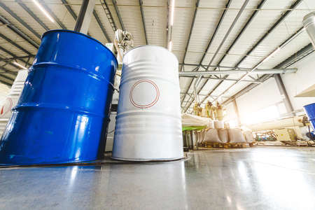 The interior of a factory for the production of polypropylene products from recycled materials. Mixing barrels and special equipment Фото со стока