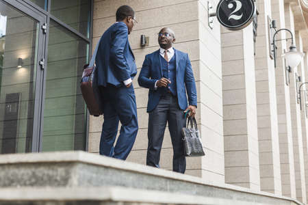 two black African American businessman in suits outdoors. Фото со стока