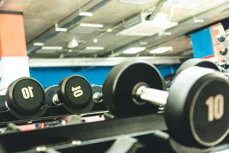 Dumbbells in the interior of the gym without people Фото со стока