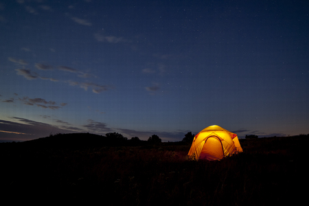 tent: A yellow tent glows at night under a starry sky in Shenandoah National Park, Virginia.