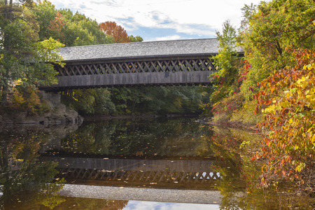 enables: The covered bridge enables pedestrians to cross the Contoocook River in teh picturesque town of Henniker, New Hampshire.