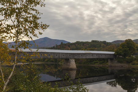 one of a kind: The wooden covered bridge connecting the towns of Cornish and Windsor is one of the longest of its kind in the United States. Stock Photo