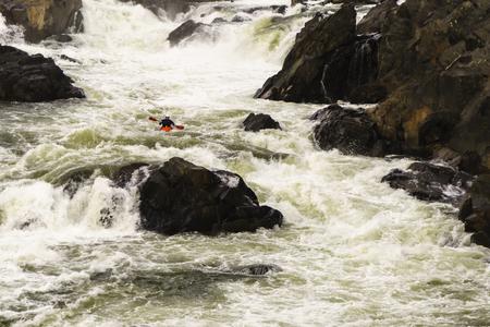 kayaker: Potomac, MD – November 28, 2015: A kayaker navigates the turbulent water of the Great Falls of the Potomac River.