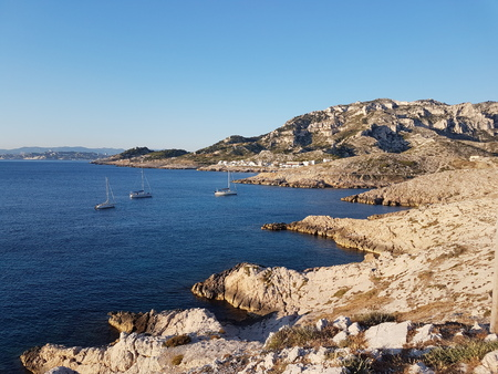 Coastline of french riviera near Marseille city. Yacht anchored in a bay of Mediterranean sea. Europe. South of France. Summer 2016.