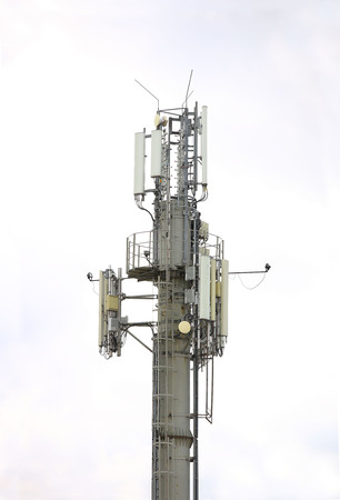 Radio tower with antennas on a blue sky background. Metal construction. Wireless network. Transmit tv radio signal. Egology of the environment. Information digitalization and high technology