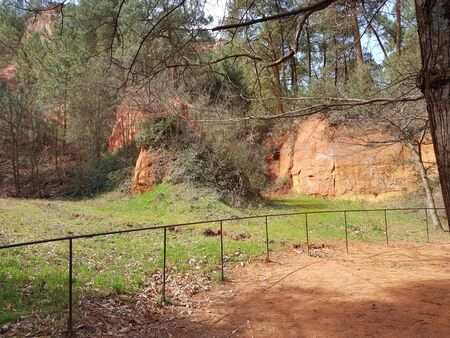 Provence is the southern region of France. Natural Geology Park in Roussillon. Remains of a mining ocher quarry. Famous tourist spot of the European continent. Martian landscape of orange cliffs.