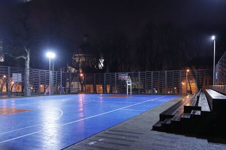 A new modern ball-free area in the lights of the night city. Evening sports in Lviv in Ukraine. Healthy lifestyle among citizens. Stadium for the competition at a later time. Youth training.