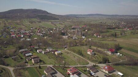 Panorama of a small European village with a Christian Catholic church in the center Cieklin, Poland Stockfoto