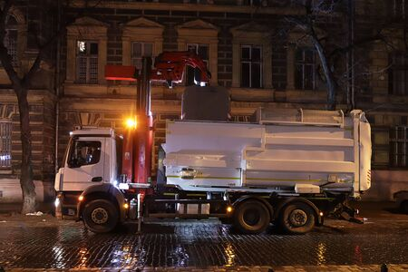 Collection and transportation of household waste by community service workers. Monitoring the environmental situation of the evening city of Lviv. Recycling of human waste in Ukraine. Garbage sorting.