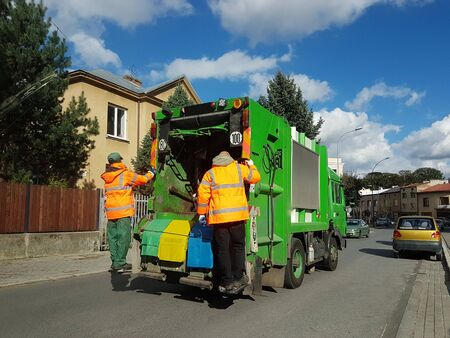 Collection and transportation of domestic garbage by municipal service employees. Control of the ecological situation in cities. Utilization of human waste. Limited speed. Territory cleaning. Archivio Fotografico