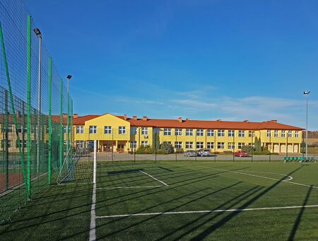 Lubno, Poland - july 9 2018:An open stadium in the courtyard of a village school. Eduction of the younger generation. Sports ground for football, volleyball and basketball. Lighting on natural sources.
