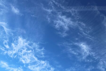 Cirrus clouds on a clear blue sky. Weather forecast. Water in a gaseous state in nature. The atmosphere of the earth. The effect of humidity on agricultural production. The symbol of freedom.