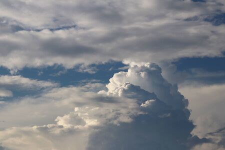 Clear blue sky with cumulus and cirrus clouds. Sunny weather. Joyful mood. High pressure. Clean air ecology. Water in a gaseous state. The source of rain and hail. Weather prediction.
