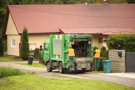Collection and transportation of domestic garbage by municipal service employees. Control of the ecological situation in cities. Utilization of human waste. Limited speed. Territory cleaning. Stock Photo