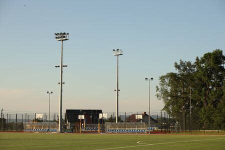 Ice lamps for outdoor lighting of a large territory located on a high aluminum pole. Bottom view of the modern lighting of the football field and sports stadium. Technological progress in lighting. Stock Photo