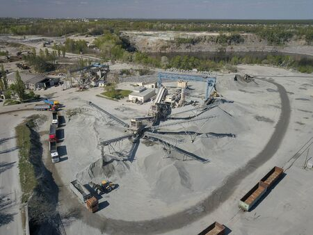 Extraction, washing, sorting and distraction of river gravel. Mining industry. Technology of obtaining a stone. A bird's eye view. Shooting with a quadrocopter. Metal construction of sorting of rubble.