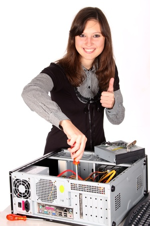 Thumb up young woman fixing computer on white background photo