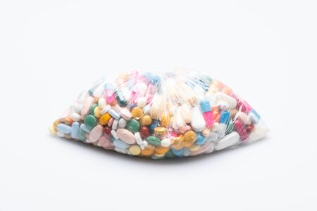 bag of pills isolated in front of a white background 版權商用圖片