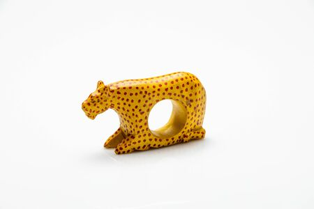 sculpture of a leopard isolated in front of a white background