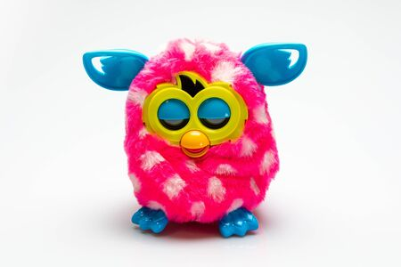 furby toy isolated in front of a white background