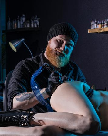 Tattoo artist creating a tattoo