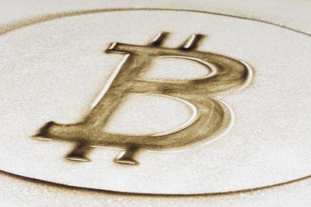 Bitcoin sign, sand painting on lightbox 스톡 콘텐츠