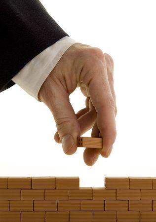 businessman building a wall