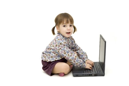 little girl working with a laptop on white background Stock Photo - 7770028