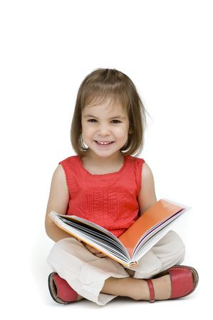 preschool education: little girl reading a book isolated on white