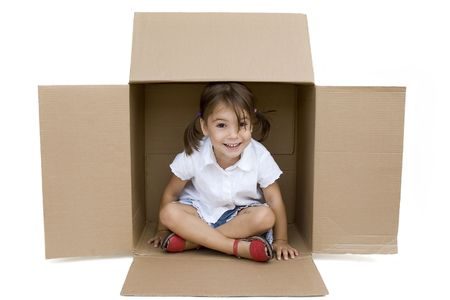 little girl inside a Box isolated on white photo