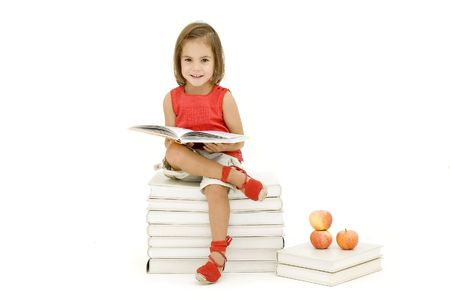 little girl reading a book isolated on white photo