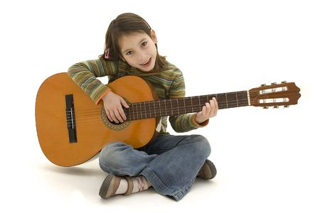 girl playing guitar: young girl playing acoustic guitar isolated on white Stock Photo