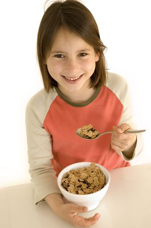 young girl with breakfast photo