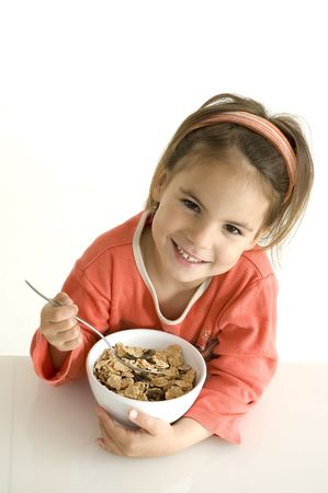 breakfast cereal: little girl with breakfast