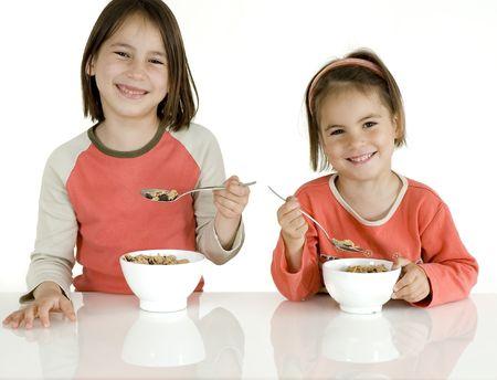 nutriments: ni�os con desayuno  Foto de archivo