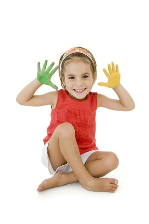 little girl with her hands painted isolated on white background photo