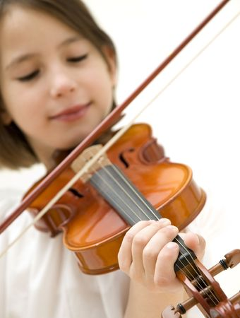 young girl closeup portrait with violin focused on hand isolated on white background photo