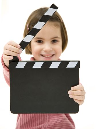 Little girl with a clapperboard isolated on white background photo