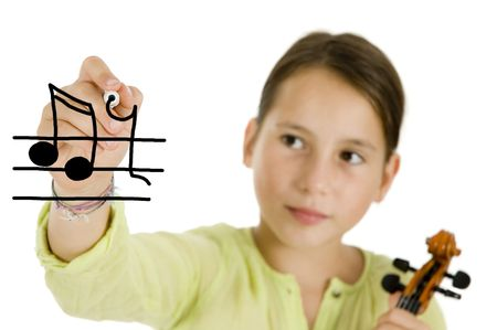 young girl holding a pen and a violin isolated on white Stock Photo