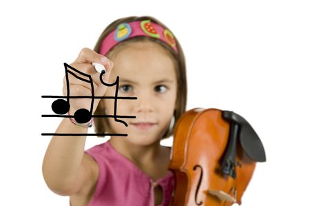 little girl holding a pen and a violin isolated on white